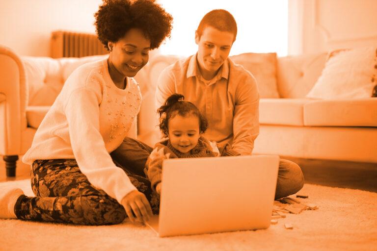 family using laptop
